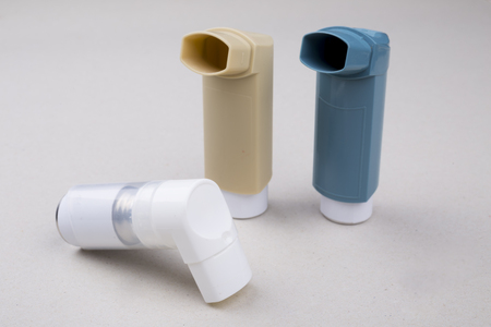 inhalation: set of asthma inhalers on a gray background