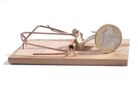 Euro coin in a wooden mousetrap, white background