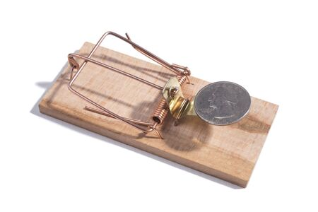 US coin quarter in a wooden mousetrap, white background Stock Photo
