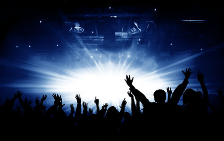 Silhouettes Of Concert And Bright Stage Lights Background Stock Photo