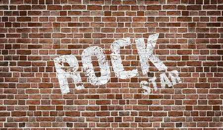 dull: studio room with tile floor and brick wall background Stock Photo