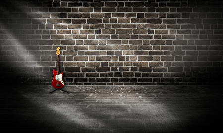 studio room with tile floor and brick wall background photo