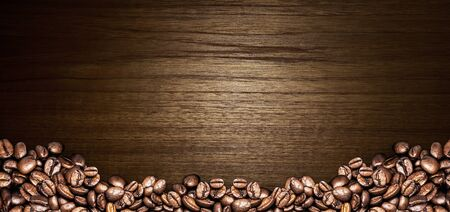 sackcloth: coffee beans on wood background