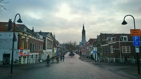 architecture: Nieuwe Langendijk street in Delft, the Netherlands, viewed from the Koepoort Cow Bridge,  by twili