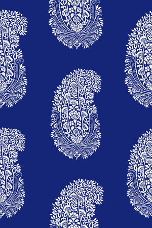 Indigo dye woodblock printed ethnic seamless paisley pattern. Traditional oriental ornament of India, ecru on cobalt blue background. Textile design.