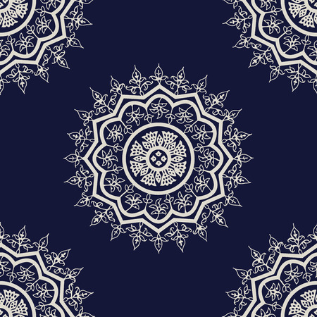 Indigo dye woodblock printed seamless ethnic floral mandala pattern. Traditional oriental ornament of India, Kashmir flowers, ecru on navy blue background. Textile design.