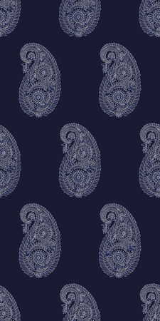 Seamless woodblock printed Indigo dye paisley pattern. Traditional oriental Indian ethnic ornament, ecru on navy blue background. Textile design.