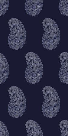 Seamless woodblock printed Indigo dye paisley pattern. Traditional oriental Indian ethnic ornament, ecru on navy blue background. Textile design.