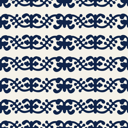 Woodblock printed indigo dye seamless ethnic floral pattern. Traditional oriental ornament of India Kashmir, vines wave motif, navy blue on ecru background. Textile design.