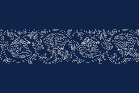 Woodblock printed indigo dye seamless ethnic floral border. Traditional oriental ornament of India, wave line of flowers and leaves, ecru on navy blue background. Textile design.
