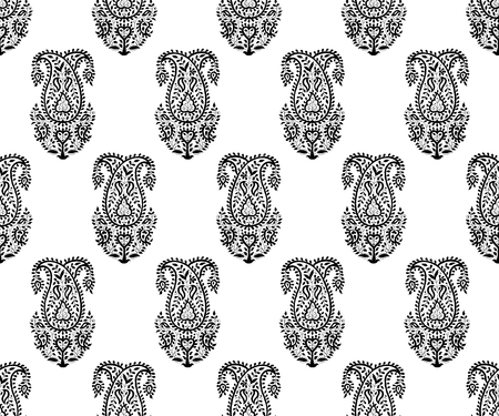 Seamless monochrome woodblock printed paisley pattern. Traditional oriental Indian ethnic ornament, black on white background. Textile design.