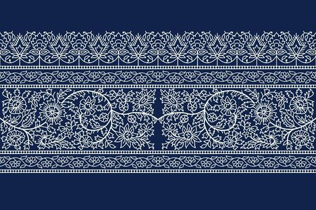 Woodblock printed indigo dye seamless floral ethnic border. Traditional oriental ornament of India, flower garland motif, ecru on navy blue background. Textile design.