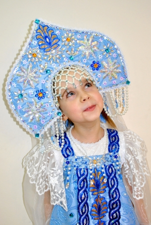 Little girl in the costume of russian Christmas character Snow Maiden photo