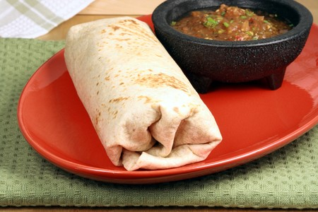 tacos: delicious mexican famous burrito with hot sauce