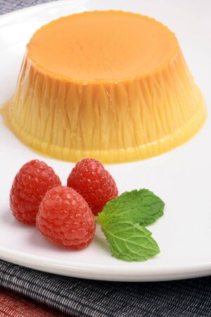 flan: Flan dessert made with prime organic milk, berries and garnished with mint