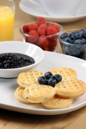 Exquisite waffle garnished with organic strawberry and blueberry photo