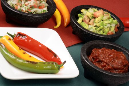 hot grilled peppers with hot pico de gallo and red peppers sauce, perfect mexican food company   photo