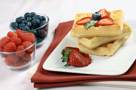 Healthy sweet  decadent belgian waffles garnished with organic berries photo