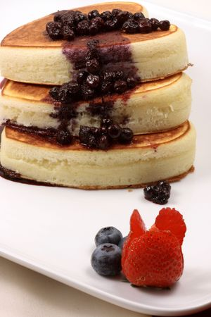 honey moon: Delicious  honey moon pancakes with organic assorted berries and homemade blueberries sauce