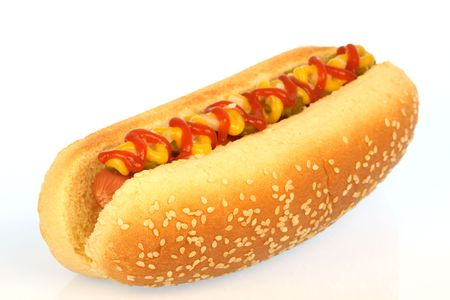 dog food: hot dog against white background with onions, pickles,ketchup and mustard on top     Stock Photo