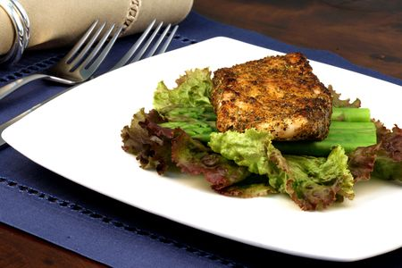asparagus bed: delicious grilled sea bass, seasoned with fine spices with asparagus and lettuce bed  Stock Photo