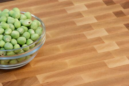 fine wood: green beans  on fine wood cutting board with wood  background    Stock Photo