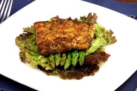 asparagus bed: delicious grilled sea bass, seasoned with fine spices with asparagus and lettuce bed