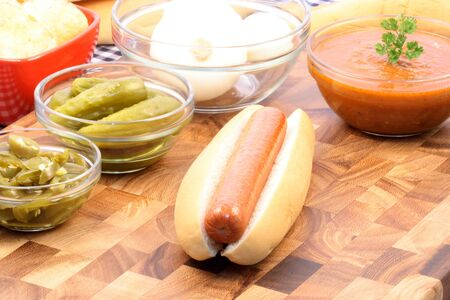 picknick: hot dog ingredients on a nice table setting rich in colors and flavors perfect for picknicks
