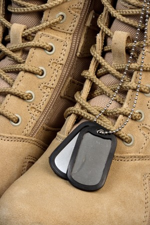 army deployment  military desert boots and tag chains, when the time comes our soldiers are ready. photo