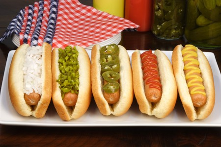 dog food: hot dogs on a nice table setting rich textures colors and flavors