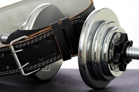 kilos: heavy dumbbell  with hard core leather bodybuilding belt