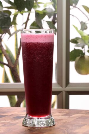 concord grape: Glass of delicious organic and fresh concord grape juicefull of antioxidants and nutrients