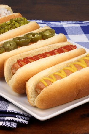 hot dog: hot dogs on a nice table setting rich textures colors and flavors   Stock Photo