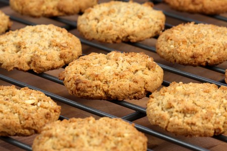 Fresh baked Stack of warm oatmeal  cookies on cooling rack, shallow DOF