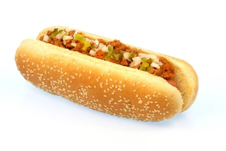wiener dog: hot dog against white background with chili , onions and pickles on top      Stock Photo