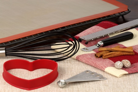 set of cookies and muffins bakeware  kitchen utensils on wood fine table  photo