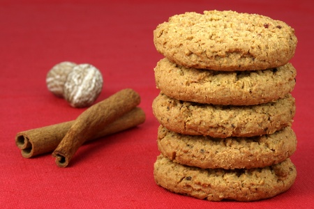 Fresh baked Stack of warm oatmeal cranberry cookies on fine tablecloth made of linen, shallow DOF photo