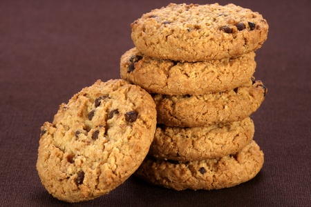 Fresh baked Stack of chocolate chips cookies on fine and fancy brown linen   photo