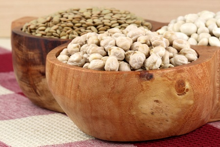 raw and dry grain legumes on rustic mexican wooden dish Stock Photo - 9264048