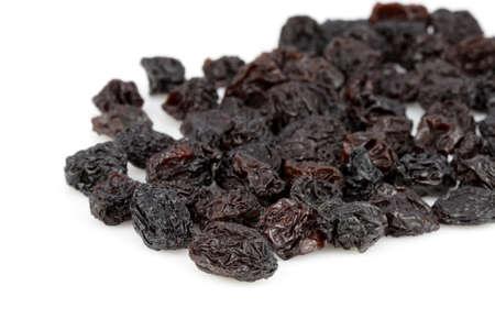 fresh organic raisins on white background   shallow D.O.F photo