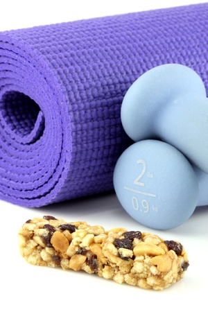 perfect losing weight combo for women, cereal bar with protein,fiber and good carbs plus a yoga mat  and  women dumbbell weights.   photo