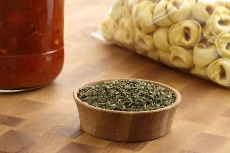 fresh and raw wholegrain tortellini  pasta with tomato sauce jar , the perfect ingredients to make an easy and fast delicious meal. photo