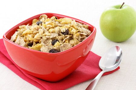 dry fruits: delicious and healthy wholegrain muesli breakfast, with lots of dry fruits, nuts, grains and a fresh apple