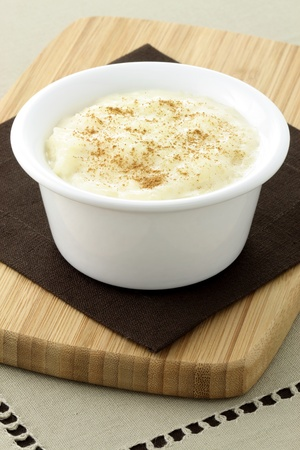 delicious rice pudding  with cinamon, raisins or brown sugar on top one of the most delicious desserts ever  photo