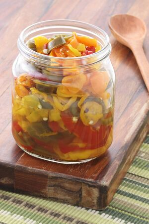 delicious sliced pickled hot jalapenos, habaneros and chile de arbol peppers that will leave a hot spicy and burnig sensation. photo