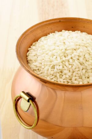 raw arborio rice used to make risotto, one of the most famous and delicious  Italian dishes Stock Photo - 10300902