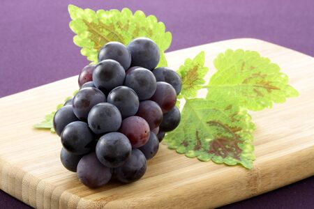 fresh delicious and healthy organic concord grapes on fine wood cutting board Stock Photo - 10300911