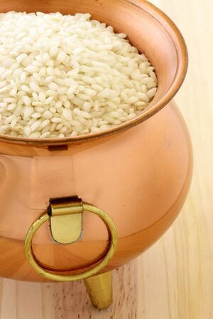 raw arborio rice used to make risotto, one of the most famous and delicious  Italian dishes Stock Photo - 10412869