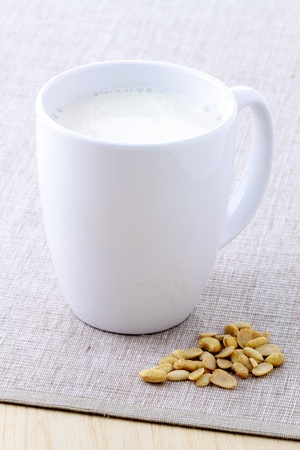 soya beans: fresh and healthy cup of soy milk made with organic soybeans