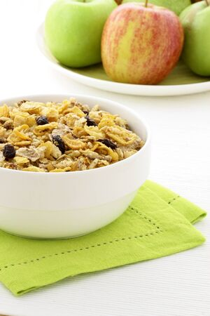 musli: delicious and healthy granola or muesli with fresh organic apples and pears , with lots of dry fruits, nuts and grains.  Stock Photo
